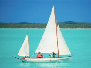 A Drascombe Longboat sailing in Chalk Sound National Park on Providenciales
